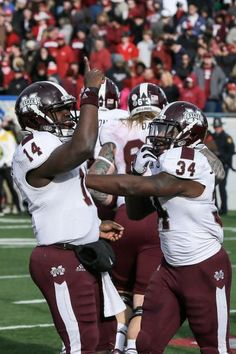 Mississippi State quarterback Damian Williams (14) celebrates with teammate running back Josh Robinson (34) after Williams' overtime game-winning touchdown. Mississippi State defeated Arkansas 24-17 in overtime. (Danny Johnston/AP)