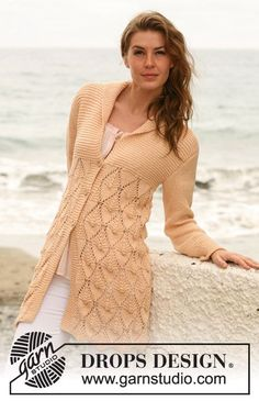 "Knitted DROPS jacket with lace pattern and shawl collar in ""Paris""."