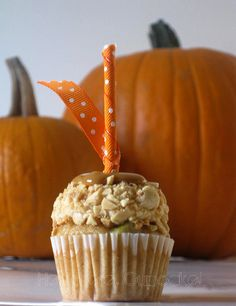 Caramel apple mini cupcake.  the detail of wrapping the stick in orange ribbon is great. apple recipes, apple desserts, mini cupcakes, cooking tips, caramel apple cupcakes, apple cakes, healthy desserts, cake recipes, caramel apples