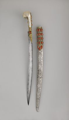 The yatagan was popular throughout the Ottoman Empire. Single-edged blade that curves slightly inward and by a hilt with no guard and two flared wings at the pommel. Date: dated 1802–3 Culture:  Anatolian or Balkan Medium: Steel, silver, gold, coral. Dimensions: Weight, 3 lb. 8 oz.; Weight without scabbard, 1 lb. 14 oz.; Length without scabbard 29 in. (73.66 cm) Length of blade 23 1/8 in.; Greatest width 2 1/4 in.; Greatest width of blade 1 1/4 in.