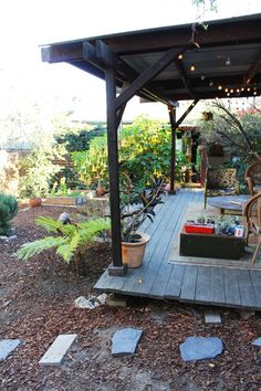 I wish we could have a covered back porch like this!