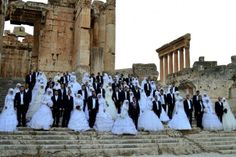 Lebanese couples attending a mass wedding in #Baalkek . (AFP)