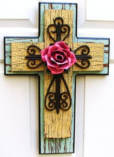 Beautiful hand-crafted stacked wooden cross designed by DiaMor De'cor.    $85.00 -maybe with out the rose