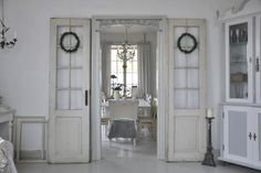love the old doors on the wall outside the regular doorway into diningroom