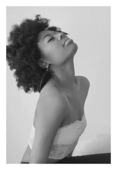 I love black women wearing their hair natural like this. It's gorgeous. I want a fro.