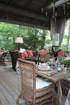 Perfect Cabin Deck. Love the architectural twig valance.