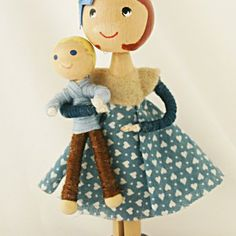 Cute little clothes pin doll holding her child! £13.00 by Troodlecraft.