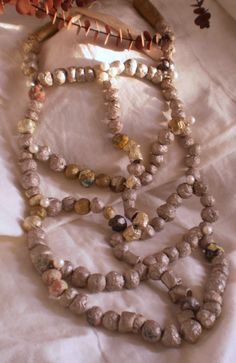 MERELYME. crafted from paper and pearls. An African Wedding Necklace.