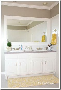 Love this idea - add feet to builder grade cabinets to make them look custom