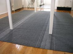 Make an area rug from industrial carpet strips from your local home improvement store.