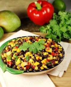 Roasted Corn, Black Bean, & Mango Salsa ~ the flavor combination of roasted corn, smoky chipotle chilies, and sweet fresh mango in this salsa is truly out-of-this-world good.   www.thekitchenismyplayground.com