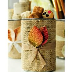 Tin Can Charm - very simple but decorative - tin can covered in burlap, natural fibers used to tie leaves on, makes a cute storage container, especially nice for fall decor. I'd be tempted to change them out with seasons, wonder how it would look with spring flowers? by Vanessa Spencer - #storage #burlap #upcycle #repurpose #reuse #recycle #tincan tå√