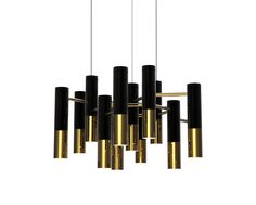 Ike suspension chandelier in brass and the lampshades in aluminium.