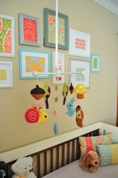 We love the idea of framing pretty fabric or scrapbook paper for an eclectic gallery wall with a pop of color! #nursery #gallerywall