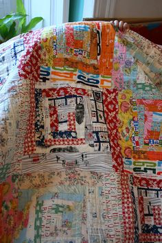log cabin quilt... Fun, nontraditional fabric choices for this. Makes it more modern and fun.