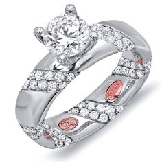 Designer Engagement Rings from DemarcoJewelry.com  Available in White or Yellow Gold 18KT and Platinum. 1.48 RDCapture her grace and endless beauty with this confident yet elegant design. We have also incorporated a unique pink diamond with every single one of our rings, symbolizing that hidden, unspoken emotion and feeling one carries in their heart about their significant other. This is not just another ring, this is a heirloom piece of jewelry.   Demarco Bridal Engagement Ring.
