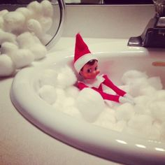 Taking a cotton ball bubble bath in the bathroom sink