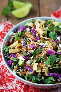 This superfood quinoa and kale salad is packed with good-for-you nutrients and tons of protein! Loaded with black beans, avocados, feta cheese, and topped bbq-ranch dressing - it's healthy AND bursting with flavor!
