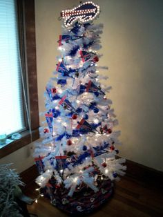 Buffalo Bills Christmas Tree. I placed a piece of Buffalo Bills material around bottom for skirt.