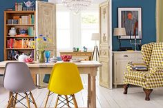 There are so many interesting things to zero in on in this photo....from the wall color to the armchair to the Eames dining chairs.  I'm loving the style mix of the bookcase!  Giving me food for thought for my own dining space!