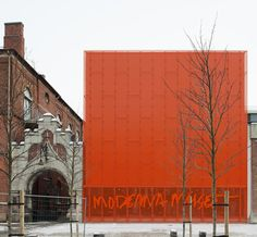 Orange large perforated metal facade. Malmö outpost of Sweden's Museum of Modern Art, from Stockholm studio Tham & Videgård Arkitekter, is both challenging, and beautiful, thanks to the new extension's jaw-dropping, eye-popping, façade – all clad in shocking, perforated orange metal.