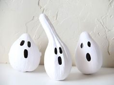 All you need for super-easy craft? Gourds, white spray paint, and a black paint pen.