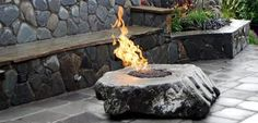 This stone fire pit has such an elegant look. Could envision it in a forested country setting or an urban environ. Design by Oasis Outdoor Environments.