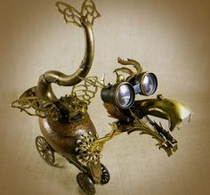 QUIRK - The Steampunk Baby Dragon #steampunk #dragon #Wagenaar #sculpture #shopping #recycled #copper #opera #glasses #googles #art