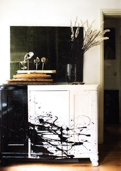 LOVE this black and white painted furniture piece.