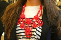 red necklace.