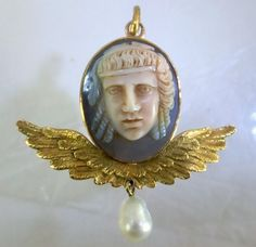 """Agate cameo locket   Ca 1800 gold mounted hard stone cameo of a ancient Greek theatrical mask. Probably Rome ca 1820, from the Grand Tour. In the back of the gold setting of the cameo located a locket with glass set """"door""""."""