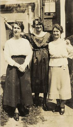 Three women standing outside the rear of a house, English, c. 1910's-1920's.