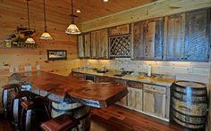 Jack Daniels Whiskey Barrels as posts.  Great idea for cabin decor!