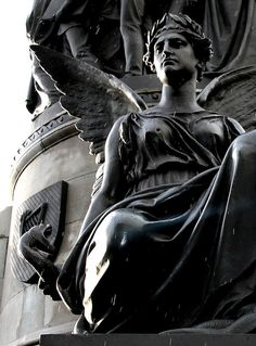 Monument to Daniel O'Connell in O'Connell Street, Dublin. Holding a snake, she symbolises O'Connell's courage. Bullethole in her breast is from the 1916 Easter Rising. #ireland #dublin #daniel_oconnell #wings #monument #bullethole