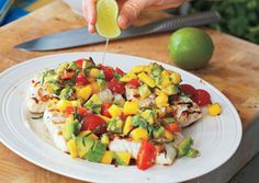 Grilled halibut with mango-avocado salsa