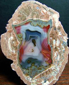 Thunder egg is a nodule-like rock, similar to a filled geode, that is formed within volcanic ash layers