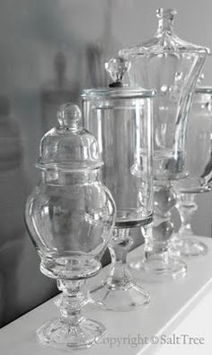 DIY Apothecary Jars. Love those pricey apothecary jars you see in all the magazines? Raid your local thrift stores or dollar store for vases, bowls, jars and candlesticks and make your own...it's easy!