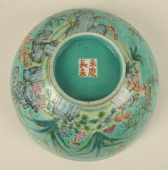 "Bottom side of Empress Dowager Cixi's porcelain bowl, Qing Dynasty (1875-1908).  Signed with a red hall mark reading Daya Zhai ""The Studio of the Greater Odes"". Within a small oval panel framed by two dragons signed Tiandi yijia chun ""The Whole World celebrating as One Family"". Signed on the base with a four character mark, Yongqing changchun ""Eternal Prosperity and Enduring Spring""."