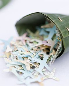 Airplane-shaped confetti punched from old maps for a destination wedding