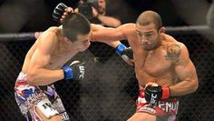 Jose Aldo (red gloves) fights Chan Sung Jung (blue gloves) during UFC 163 at HSBC Arena.