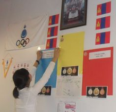 """Tuvshinbayar's name added to the Olympic Village NOC office """"wall of fame"""" for his silver medal on Aug 2. office walls, offic wall, noc offic"""