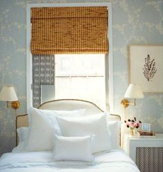 gold sconces, light blue and white bright bedroom