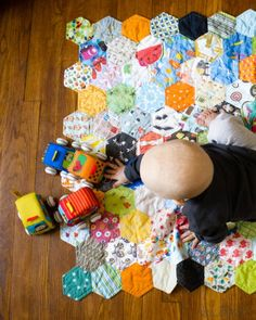 An I Spy EPP Hexagon Quilt, link to tutorial to finish edges without binding.