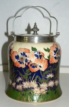 Doulton Burslem Poppy biscuit barrel with silver plated lid