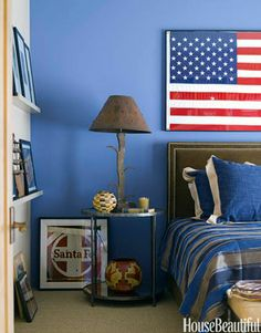 To coordinate with the flag in this Santa Fe, New Mexico, bedroom, designer Emily Henry painted one wall in Enchanting Sky by Dunn-Edwards.