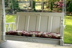 Porch swing made from repurposed/upcycled furniture and door.