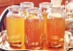 Apple Pie Moonshine...:)  1 gal spiced apple cider  1 gal apple juice  8-10 cinnamon sticks  1-1/2 c. granulated sugar  1-1/2 c. brown sugar {I use light brown}  750 ml bottle of 190 proof grain alcohol    Combine all ingredients in a large stock pot, except for the alcohol, and bring to a boil.  Remove the mixture from heat & let cool to room temperature.  Once the mixture is completely cool, add in the alcohol.