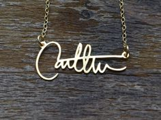 Signature necklace by Brevity Jewelry. Yep, that's your signature. Pretty personal and special.