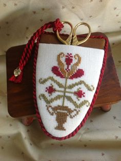 Hand stitched cross stitched floral motif scissor case with gold toned scissors