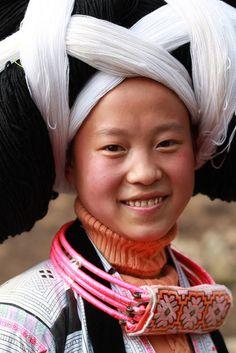 Asia - China / Guizhou + Guangxi   Changjiao Miao woman wearing her traditional necklace and elaborate hair style   © RURO photography